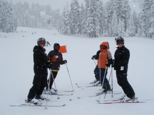 Scouts trying to stand on skis